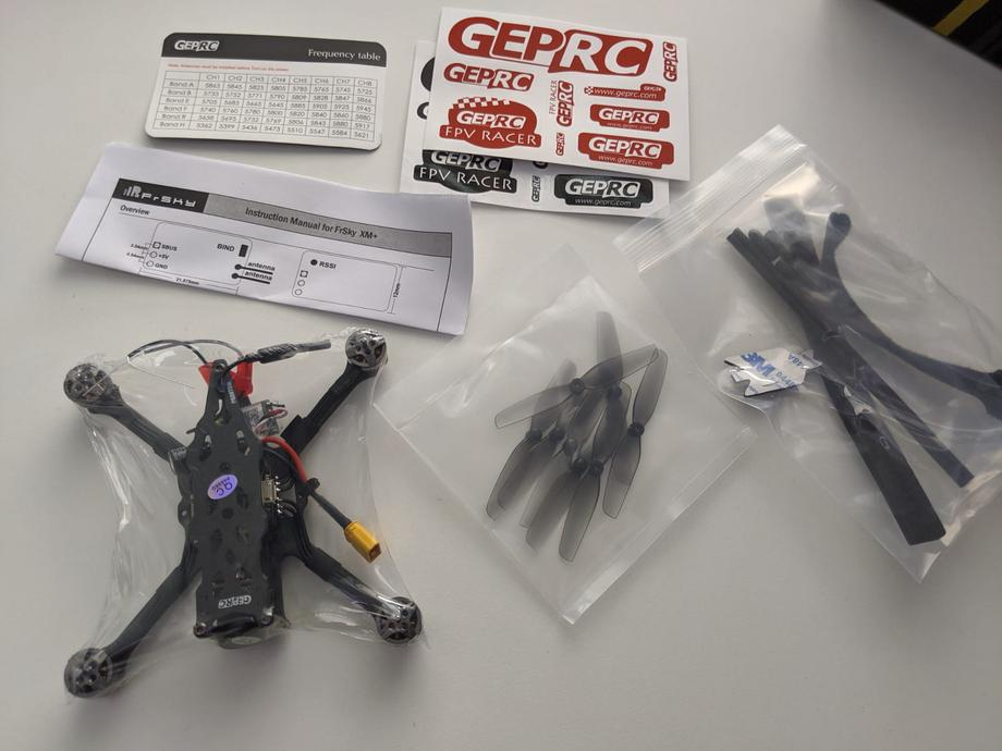 GEPRC Phantom quad and parts on the table
