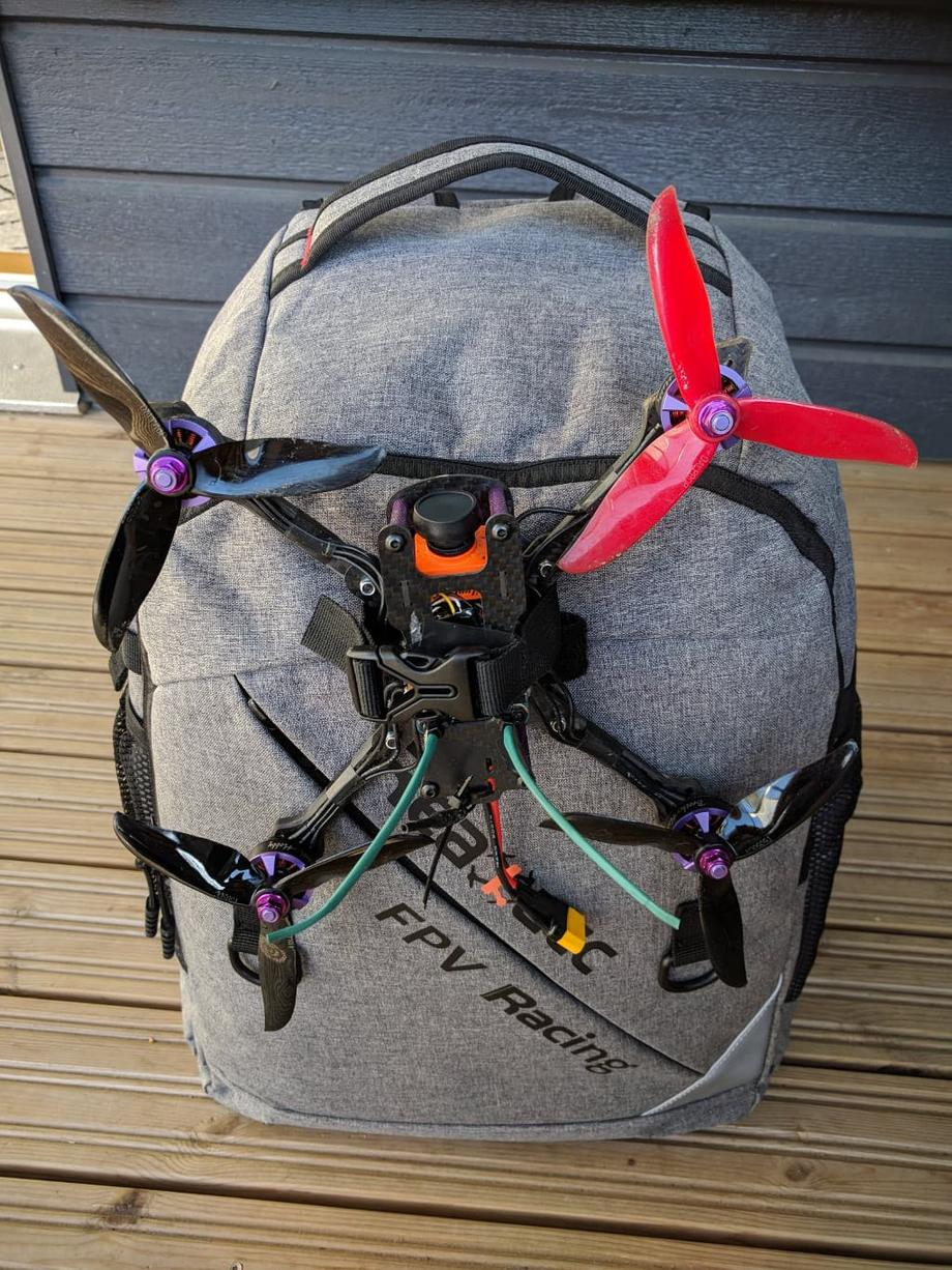 Realacc backpack with a drone attached to it