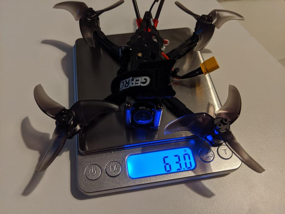 GEPRC Phantom on a scale weighing 63 grams without a battery