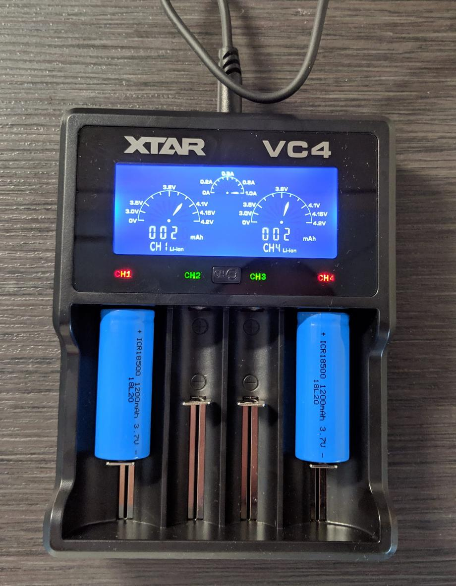 Xtar battery charger charging a pair of 18500 batteries